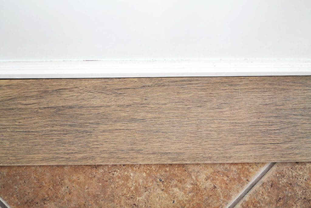 Our flooring solid wood vs faux wood tile chris loves julia img1388 dailygadgetfo Choice Image