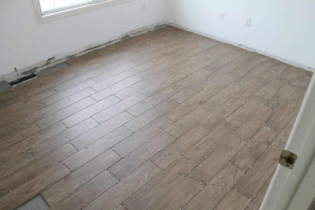 Tips for achieving realistic faux wood tile chris loves for Laying flooring