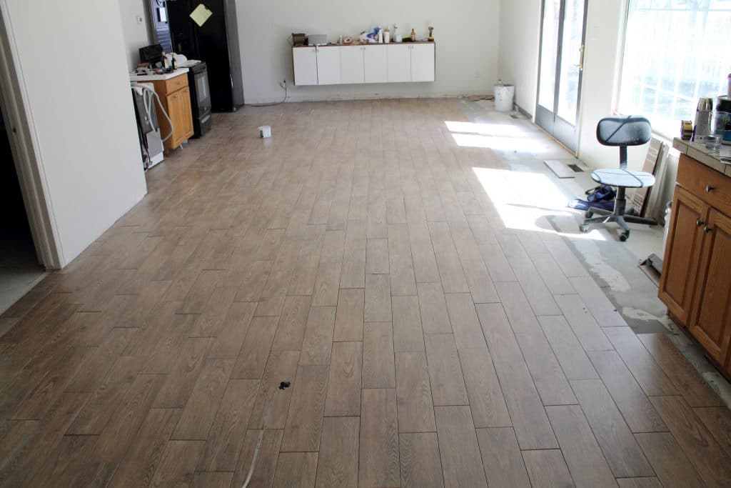 Our flooring solid wood vs faux wood tile chris loves julia slow and steady lays the tile dailygadgetfo Choice Image