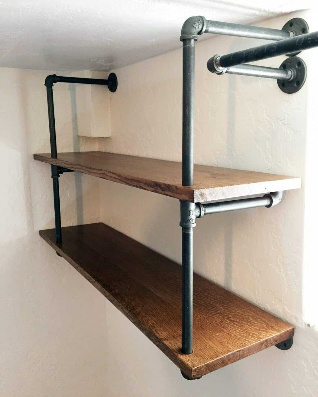 Diy industrial pipe shelving chris loves julia for Diy industrial bookshelf