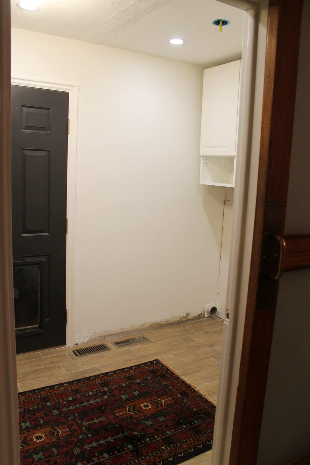 Laundry Room Progress: Paint and Cabinets! - Chris Loves Julia