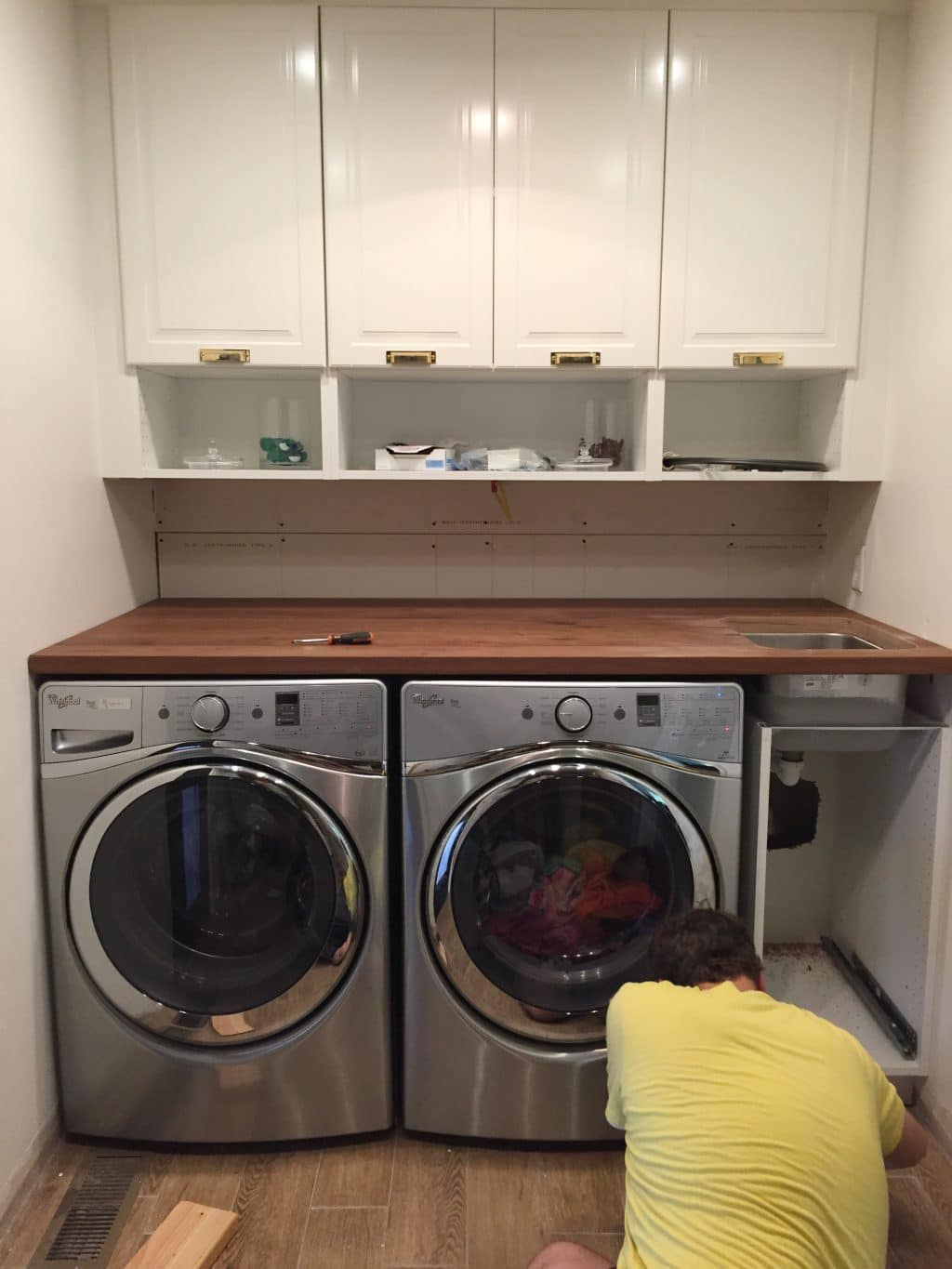 A Walnut Counter And Backsplash In The Laundry Room