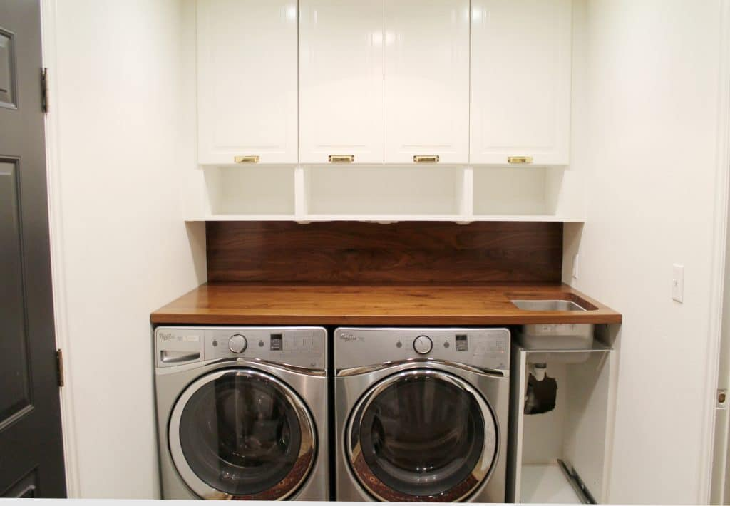A walnut counter and backsplash in the laundry room for Kitchen cabinet washing machine
