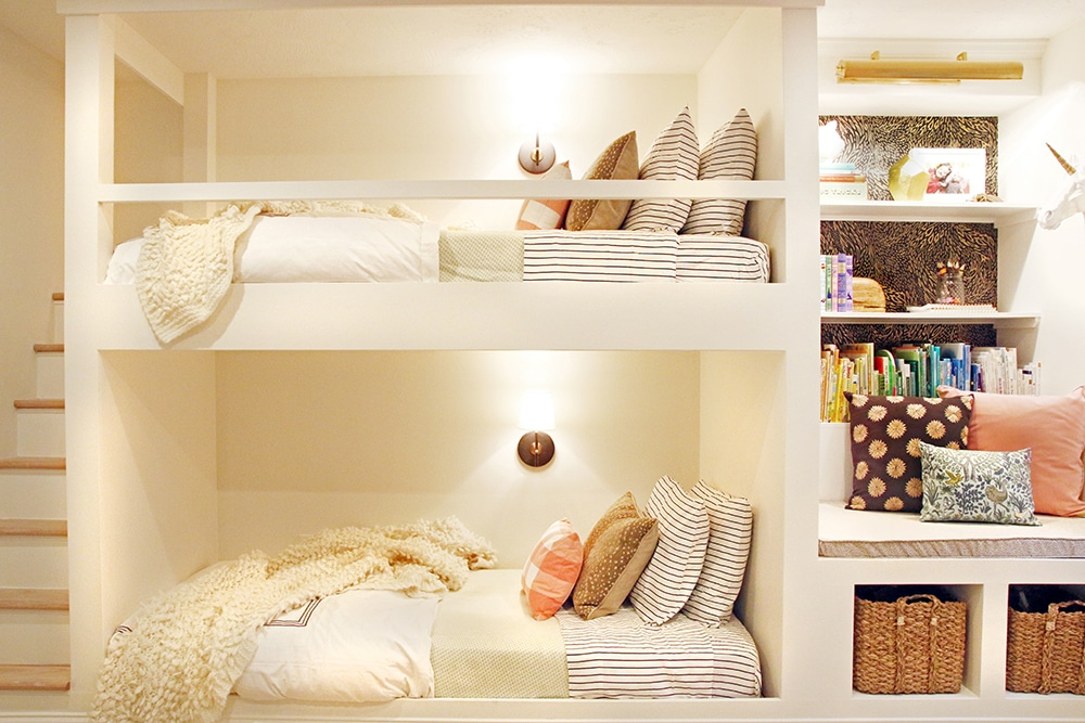 Built in bunkbeds with stairs and a reading nook!