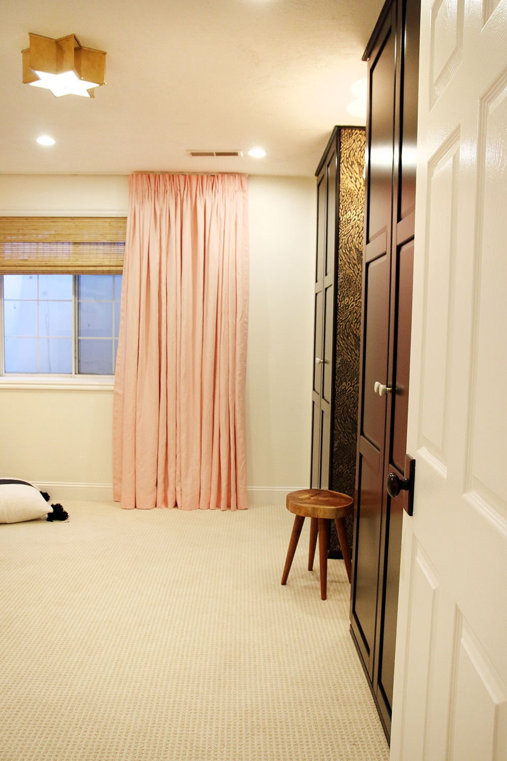Floor to ceiling pale pink curtains
