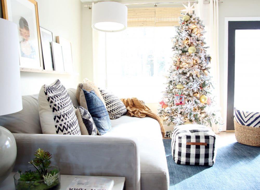 Playful flocked Christmas tree in Chris Loves Julia's Living Room