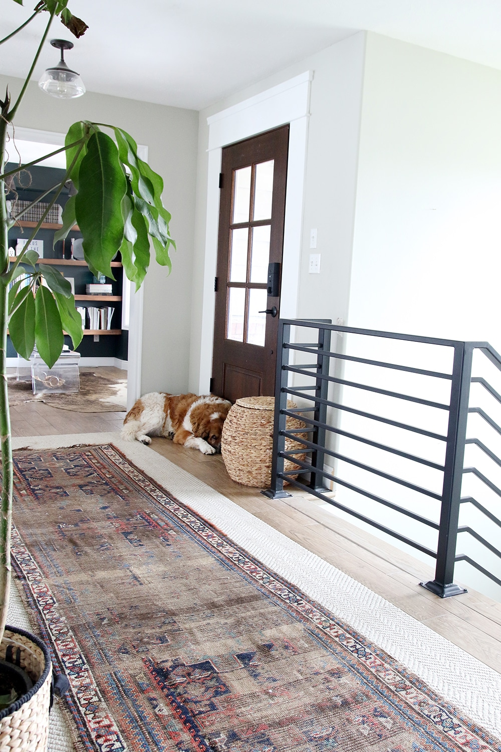 Horizontal railing and vintage rug