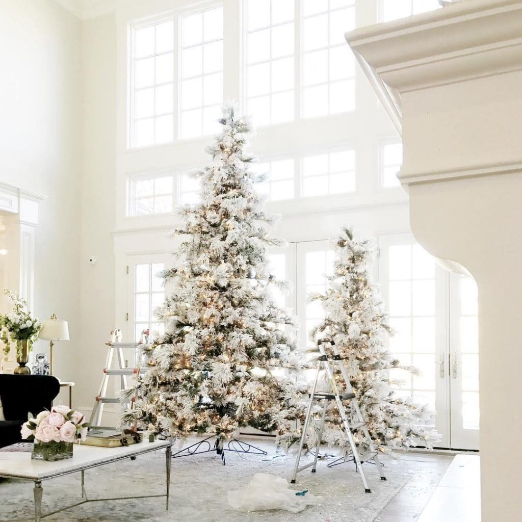 Side by Side flocked trees in Rachel Parcell's home
