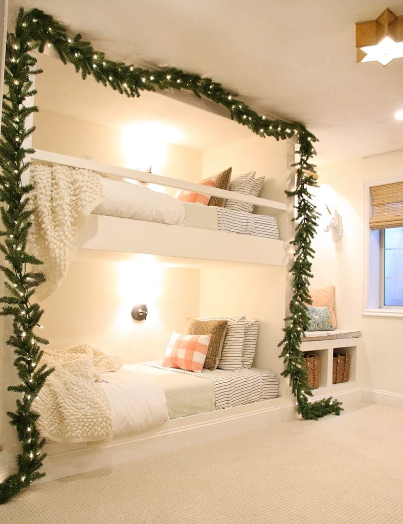 The sweetest bunks surrounded by garland for Christmas