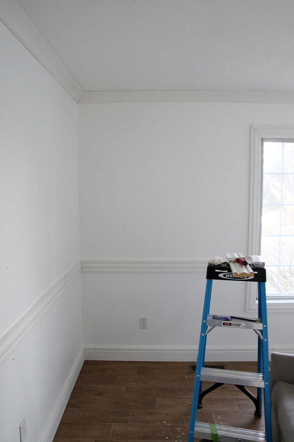 adding wainscoting in the nursery one room challenge week 2