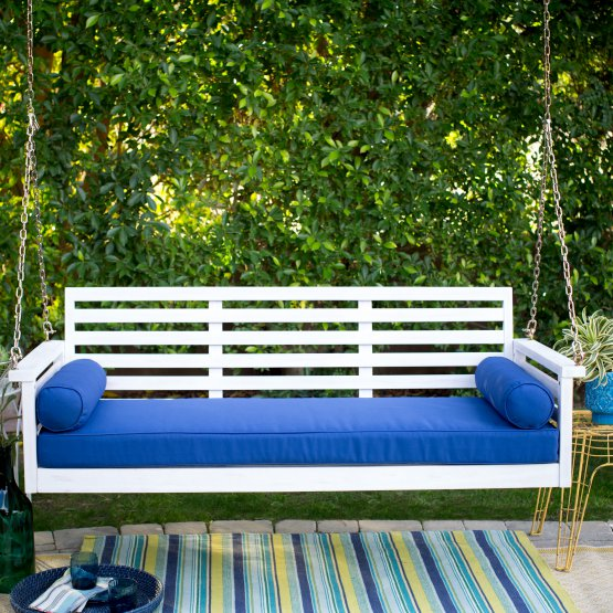 it came in a white version with bright blue cushions or a wood version with tan cushions if it came in a white version with tan definitely - Front Porch Swing