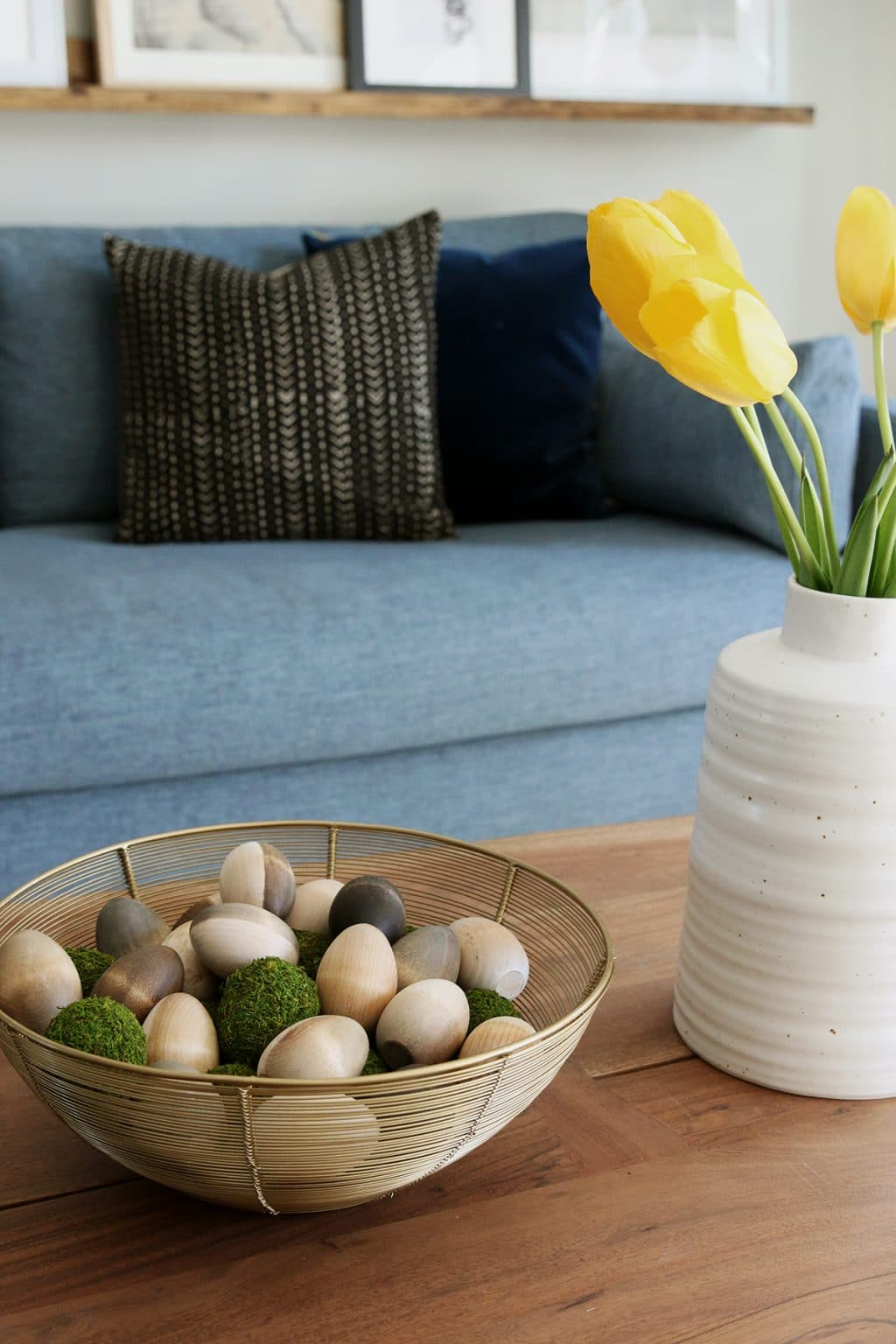 An Easy DIY Easter Project: Staining Wood Eggs! Wooden eggs in a gold bowl on a coffee table.