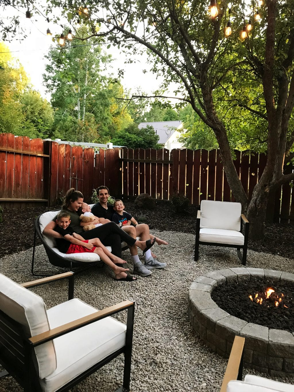 Family outside at their new fire pit