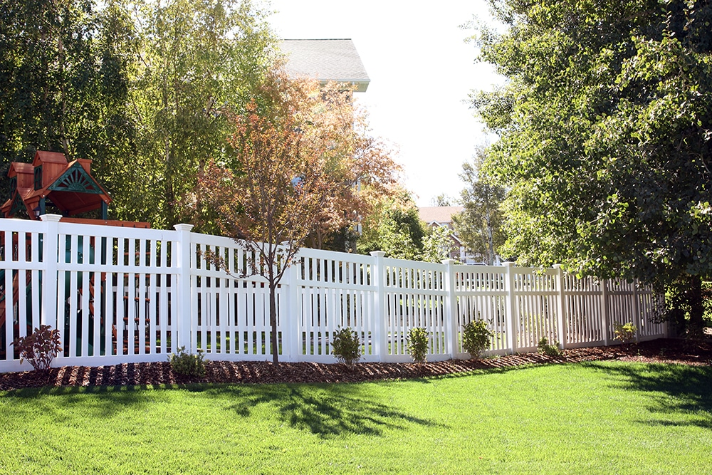 Fence with landscaping in Summer