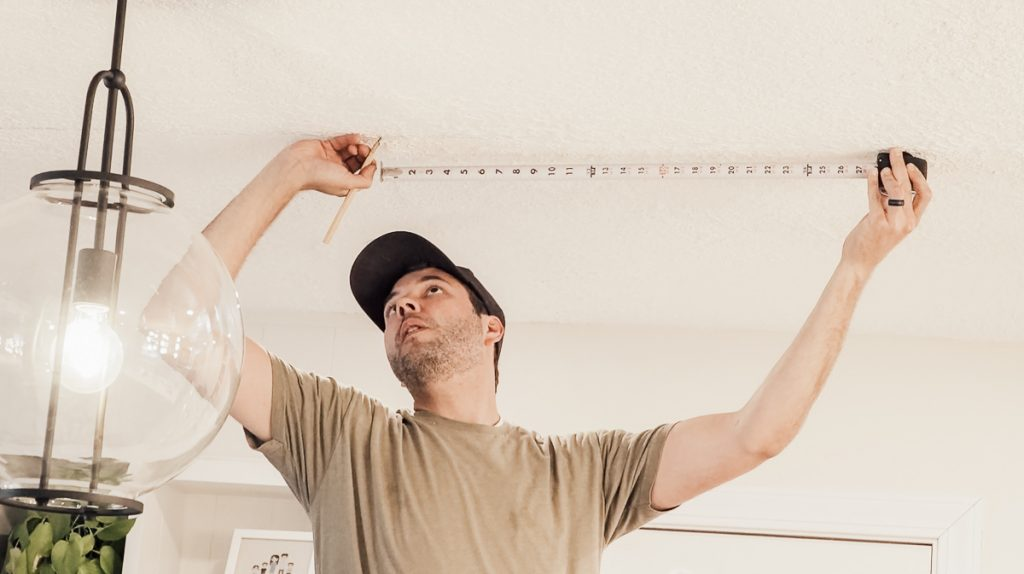 Installing Faux Wood Beams on Your Ceiling: Find and mark the ceiling joists