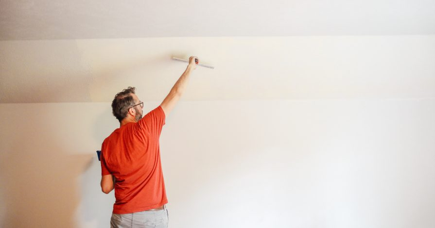 Skimming a textured wall before hanging wallpaper