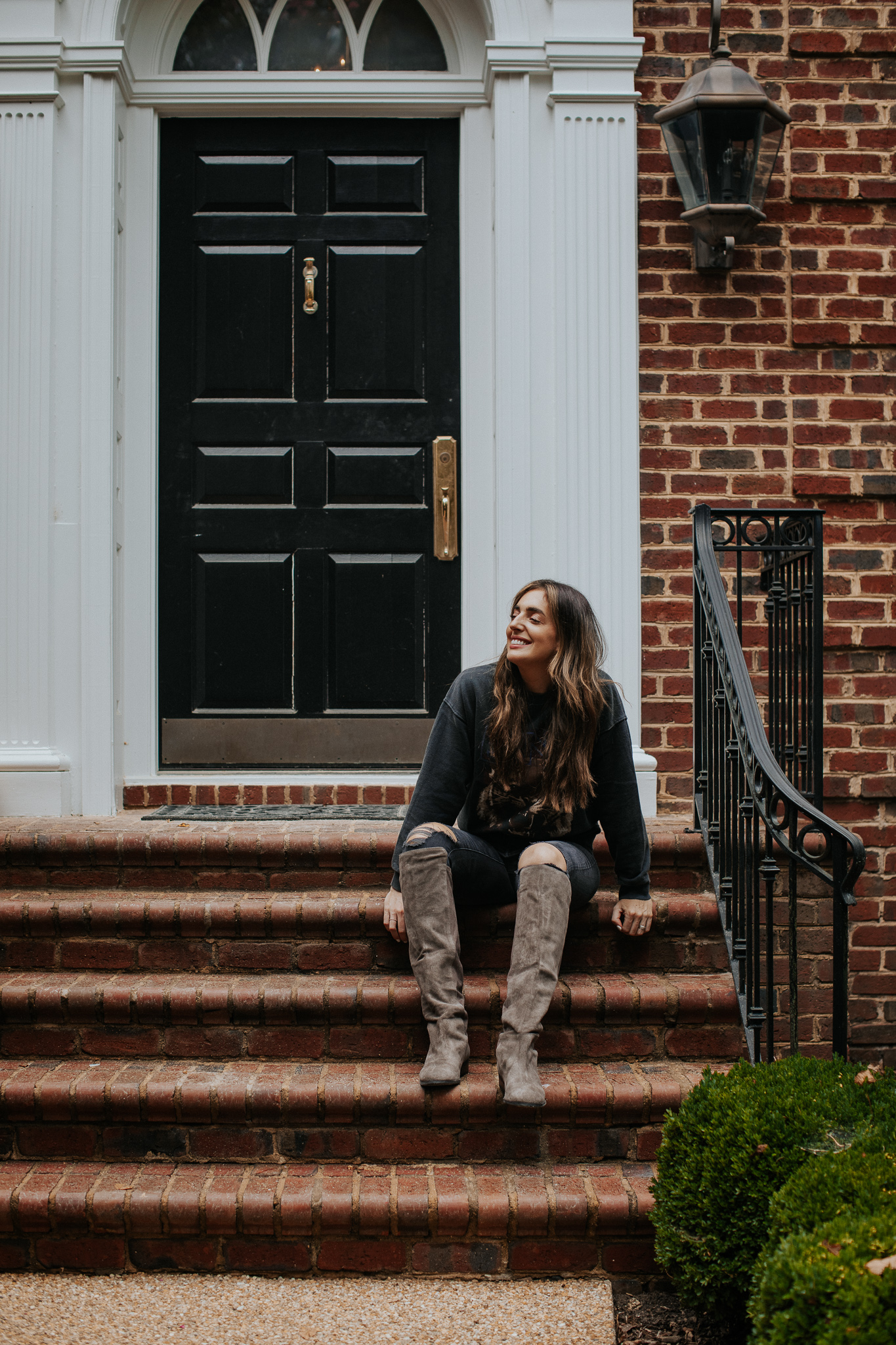 fall boots on the front porch